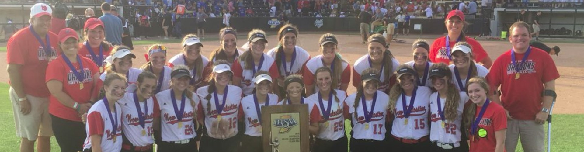 The New Palestine High School Softball team celebrating a Class 3A state championship.